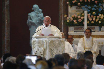 "Pope Francis leads Mass in the sanctuary of the Virgin of Charity in El Cobre, Cuba, Tuesday, Sept. 22, 2015. Pope Francis on Tuesday called on Cubans to rediscover their Catholic heritage and live a ""revolution of tenderness,"" powerful words in a country whose 1959 revolution installed an atheist, communist government that sought to replace the church as the guiding force in people's lives. (Tony Gentile/Pool via AP)"