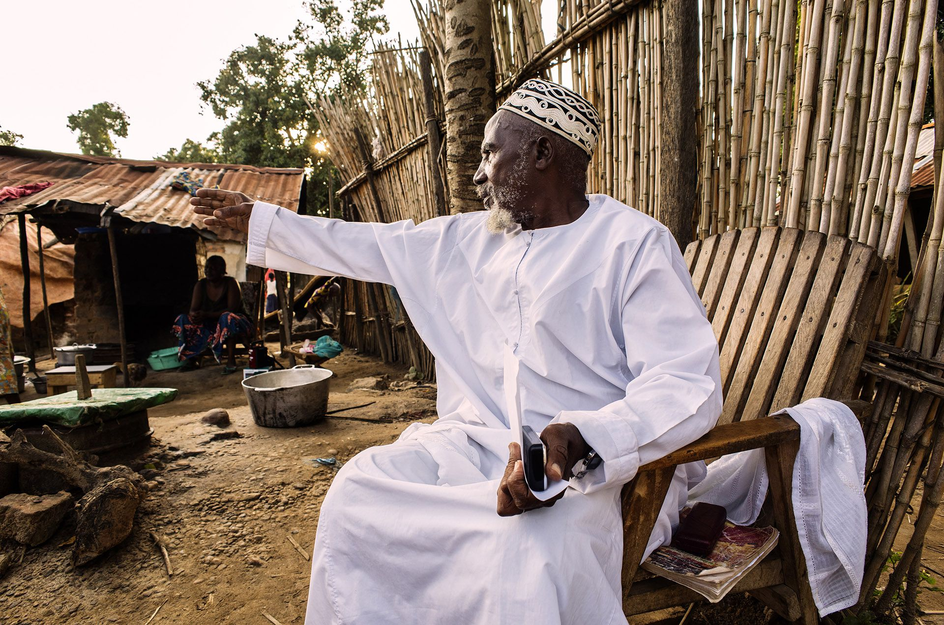"""Central African Refugees / DRC As the sun sets, Imam Moussa Bawa, 72, gestures toward his home in Zongo, Equateur Province, DRC on 29 August, 2014. The Imam was born in nearby Libenge, DRC and has lived in Zongo for 34 years. """"During the 34 years that I've been here, there have never been problems between Christians and Muslims,"""" he says. """"In Bangui [capital of neighboring Central African Republic] mosques have been destroyed. I've heard that more than 200 mosques have been destroyed in CAR. It's a political problem. There is a need for reconciliation, and I'm ready to help."""" Conflict in CAR has caused more than a million people to flee their homes, one-quarter of them crossing an international border in their search for safety. Inter-communal violence between Christians and Muslims in CAR has further complicated the situation, for both those still inside the country, and for refugees abroad. UNHCR / B. Sokol / August 2014"""