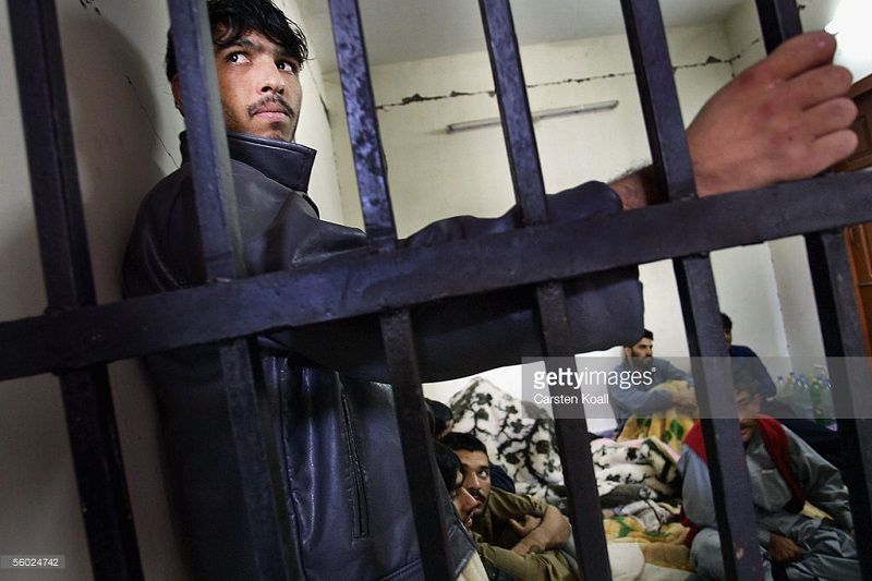 MUZAFFARABAD, PAKISTAN - OCTOBER 27: Inmates are held in the police prison on October 27, 2005 in Muzaffarabad, Pakistan controlled Kashmir. The prisons in this region were damaged in the earthquake, inmates have been given treatment from the German red cross. The current death toll is now believed to be over 54,000 from the South Asian earthquake that happened over 2 weeks ago. Over 3 million people are without proper shelter and aid organizations including the U.N are warning that thousands could die in remote mountainous regions as Winter approaches. Atleast 1,400 died in Indian-Kashmir. (Photo by Carsten Koall/Getty Images)