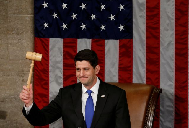 U.S. House Speaker Paul Ryan, R-Wis., raises the gavel during the opening session of the new Congress on Capitol Hill in Washington Jan. 3. Ryan, who is Catholic, was re-elected speaker of the House of Representatives earlier in the day. (CNS photo/Jonathan Ernst, Reuters) See CONGRESS-RELIGIONS-PEW Jan. 3, 2016.