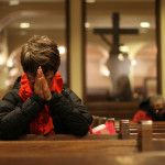 A woman prays during a 2013 Ash Wednesday Mass at St. Francis of Assisi Church in New York. Catholics are called on to reinvigorate their lives of prayer during the season of Lent. (CNS photo/Gregory A. Shemitz) See MIDST March 2, 2015.