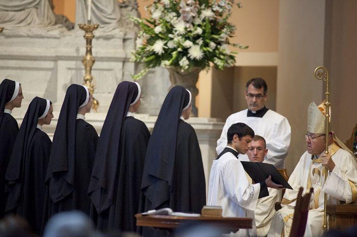 Five sisters of the Dominican Sisters of St. Cecilia Congregation in Nashville, Tenn., face Nashville Bishop David R. Choby during the July 25 Mass where they made their final profession of religious vows at the Cathedral of the Incarnation. Making their final profession were Sister Maria Benedicta Mantia, Sister Mary Margaret Taranto, Sister Dominica Bickerton, Sister Rita Marie Kampa, and Sister Maria Fracesca Wiley. (CNS photo/Rick Musacchio, Tennessee Register) (July 25, 2014)