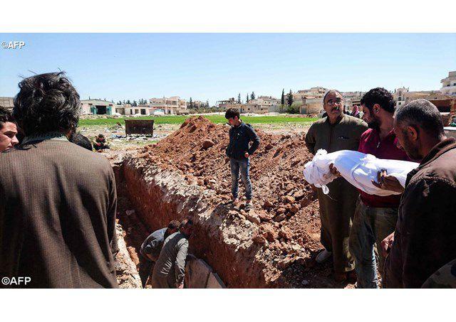 Chôn cất những người bị giết hại - AFP